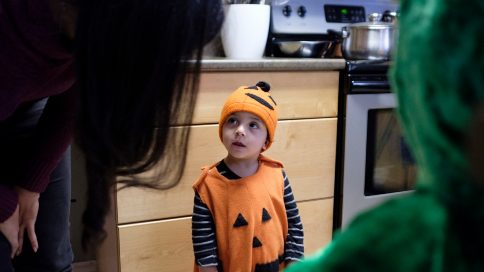 Ahmad Arafat dresses up as a pumpkin for his first Halloween.
