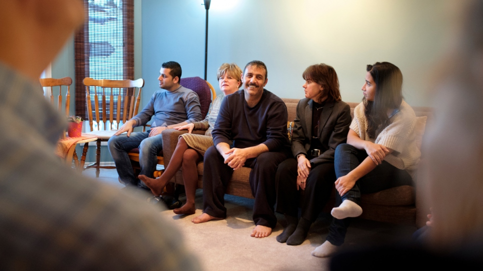 Hussein Arafat relaxes with the family's sponsors and new friends at their home.