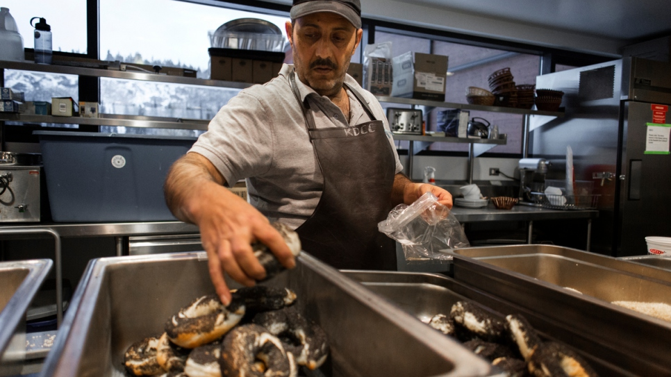 Hussein Arafat works early mornings for a local bagel company in Whitehorse.