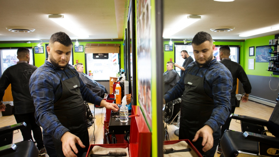 Ismail Arafat works seven days a week at a barber shop in Whitehorse.