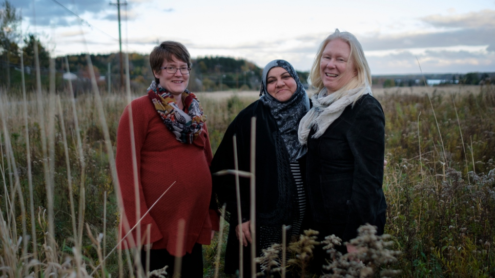 Rabiaa stands with sponsors Bronwen and Cindy in Antigonish, Canada.