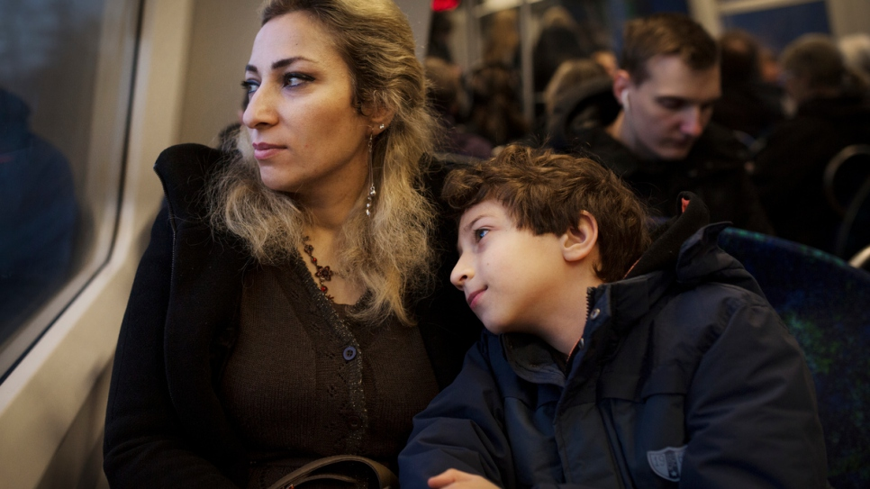 Manal on the train with her eight-year-old son Karam.