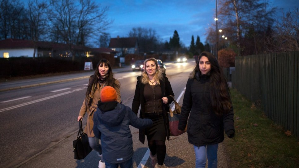 Manal and her children walk home to their flat in the suburbs of Copenhagen.