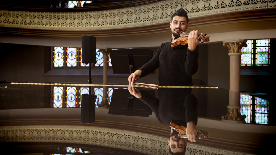 Sari plays his violin in the Alix Goolden Performance Hall.