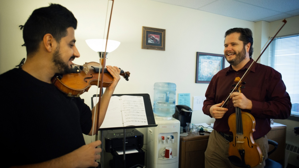 Sari practices with his mentor, Michael, at the Victoria Conservatory of Music.