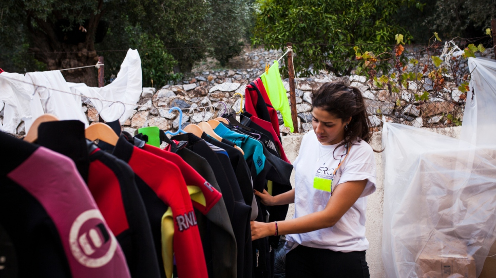 Sarah checks the wetsuits and equipment at the search and rescue organisation where she volunteers in Greece.
