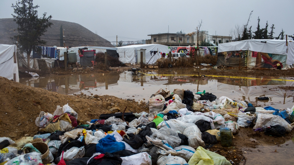 Garbage bags pile up on the roadside at an informal settlement in Tal Sarhoun, Bekaa Valley.