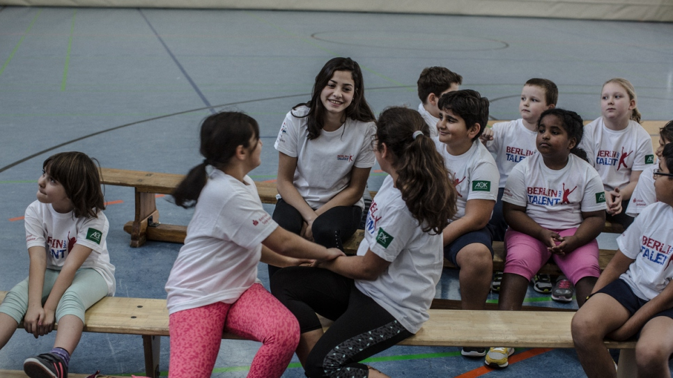 Syrian swimmer Yusra Mardini interacts with students during a press event to promote sports at a primary school in Berlin Spandau.