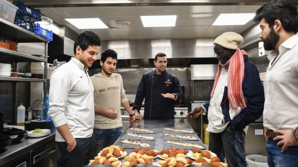 Rami Anis and Yiech Pur Biel have dinner at refugee chef Mohammed el-Khaldy's restaurant.