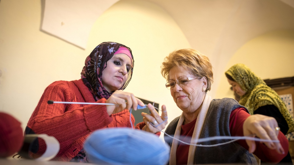 At a former monastery in the village of Forchtenstein, Afghan and Austrian women knit together.