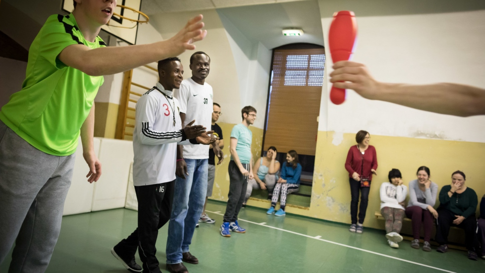 Kingsley Okonweze, 25, and Amen Goody Saint Paul, 23, from Nigeria teach sports to handicapped people in a Caritas-run home for the disabled in the village of Wimpassing an der Leitha.