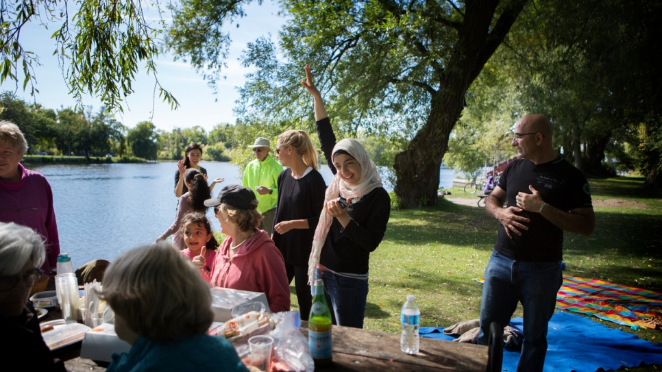 Canadians who are sponsoring the Nouman family organize activities like this picnic for the recently-arrived Syrian family.