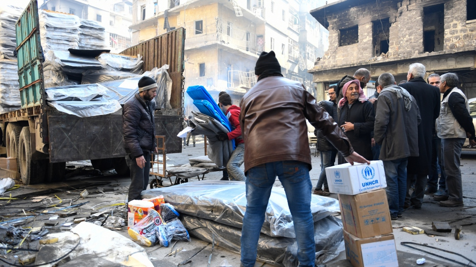 Residents of Aleppo receive crucial relief items from UNHCR and other UN partners in the Al-Sha'aar neighborhood of eastern Aleppo.