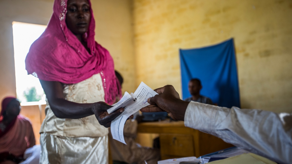 Samira Hassan takes the receipt of her application for a Chadian national ID card. Her four children will receive theirs at the age of 15.