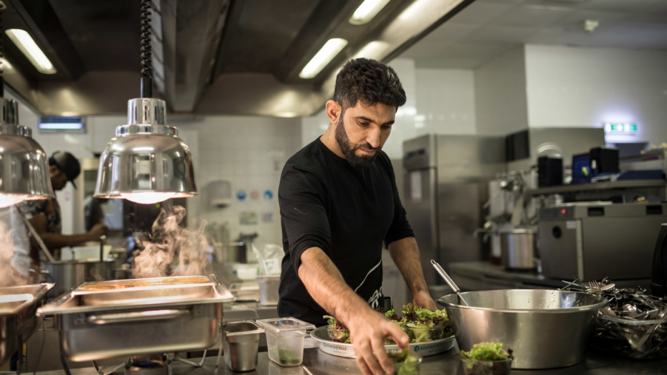 Sherahmad Razi, 32, from Afghanistan, helps out in the kitchen.
