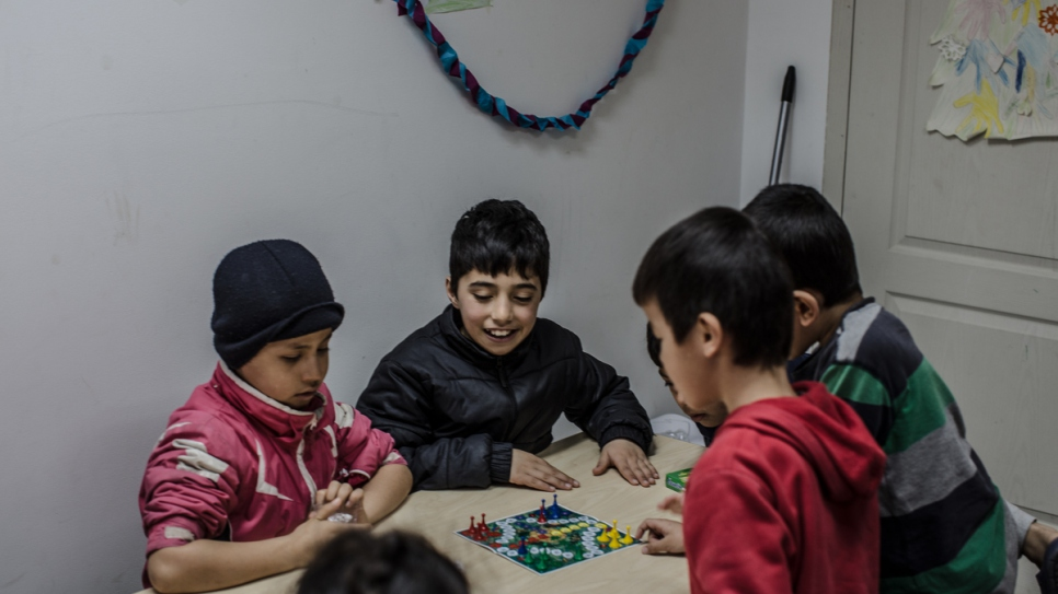 Afghan refugee children play in a kindergarten in a government shelter.