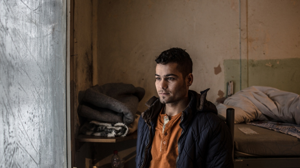 Kiramat, 17, a refugee from Afghanistan has found temporary accommodation in a government shelter.
