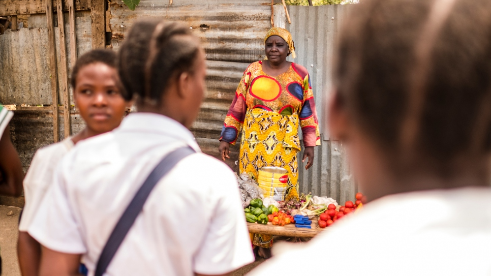 Rehema Kankindi, a Burundian refugee, sells vegetables on a street stall in Uvira, Democratic Republic of the Congo.  She fled across the border in 2015 after her stepson and two of her sons were killed in Burundi.
