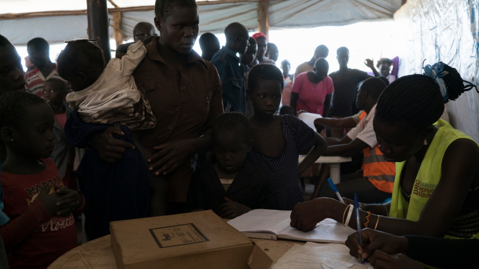 South Sudanese refugee Sidah Hawa being registered with her children at Kuluba transit centre.