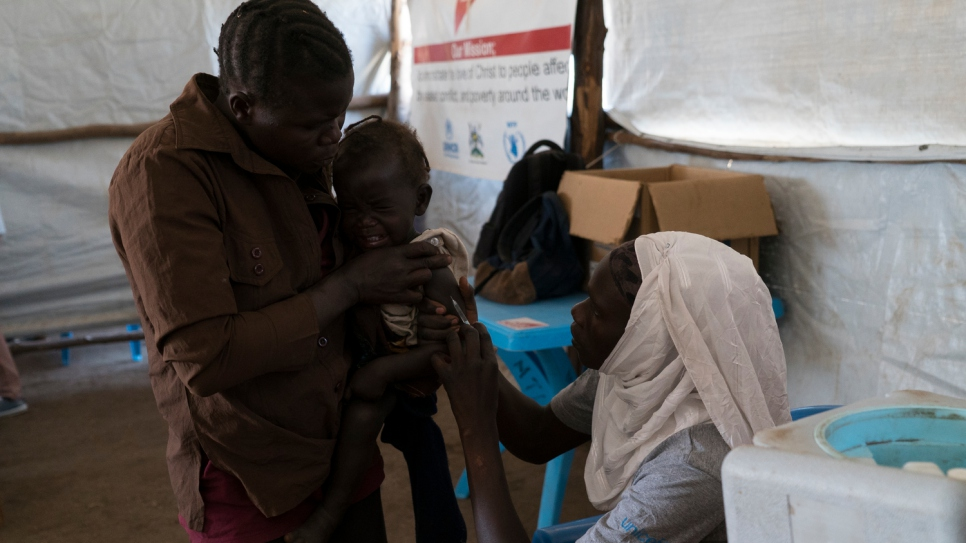 After arriving at Kuluba transit centre, refugee children are given a medical check and vaccinated against disease.