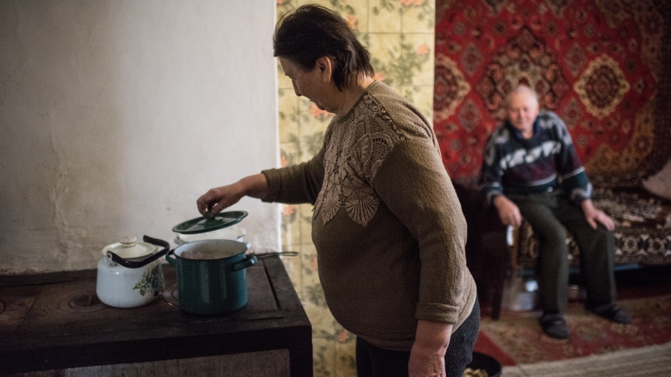 Nina, 62, and Victor, 67, at home in the village of Luhanske, Donetsk.