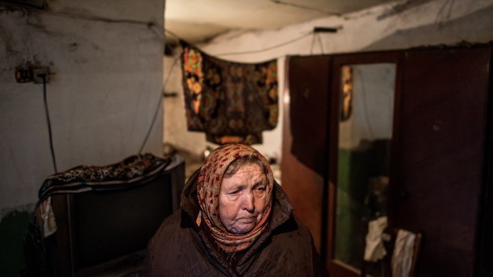 Halyna, 79, has received a coal supply to heat her home in the village of Luhanske, Donetsk.