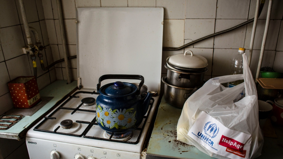 The kitchen stove inside the apartment that Hanna shares with her sick husband Oleksiy in Shchastya.