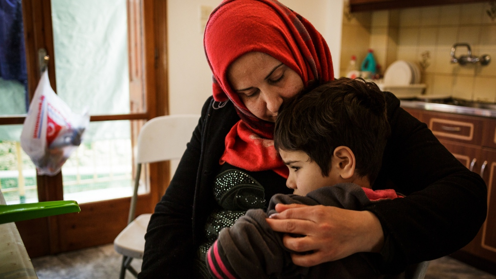 Falak hugs her five-year-old son, Morad, who has undergone three operations on his knee after being injured during a missile attack in Syria.