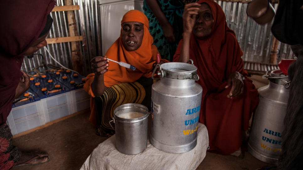 "Jamila and her colleagues test milk before accepting it. ""We have been given modern equipment to test the milk. If it has a drop of water we would know, and we will only accept pure milk; we only sell the best quality."""