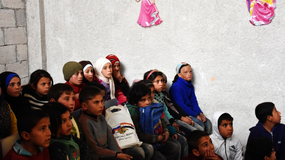 Wafaa, in blue, sits with her classmates, who have all been displaced by six years of war in Syria.