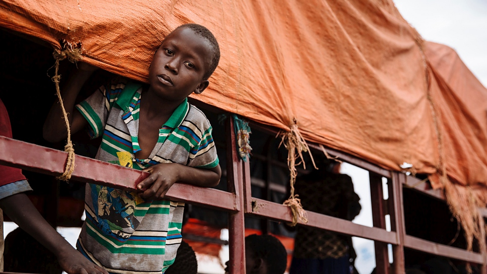 A South Sudanese refugee looks out of a truck before being transported to the recently established Imvepi settlement, at the Imvepi Reception Centre, Arua District, Northern Region, Uganda.