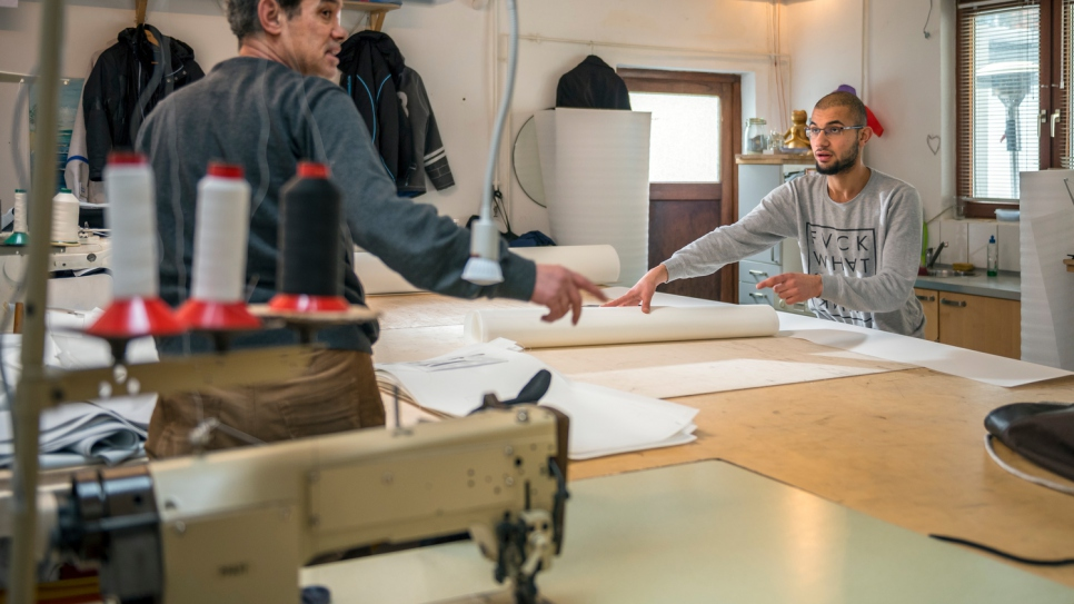 """It's really amazing – so many German people have helped us,"" says curtain maker Mohammed (left), 51, who now works with his son Yousef at the Kiel sailmaking company Coastworxx."