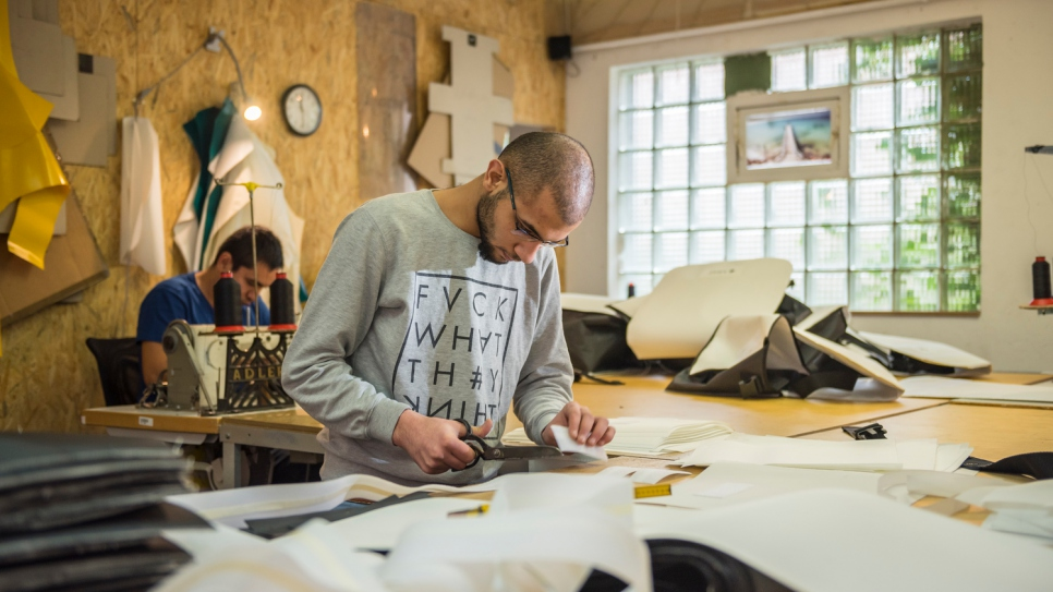 In Damascus, Yousef, 23, used to make curtains with his father. Now refugees in Kiel, Germany, they put their skills to good use at a sail-making company named Coastworxx.