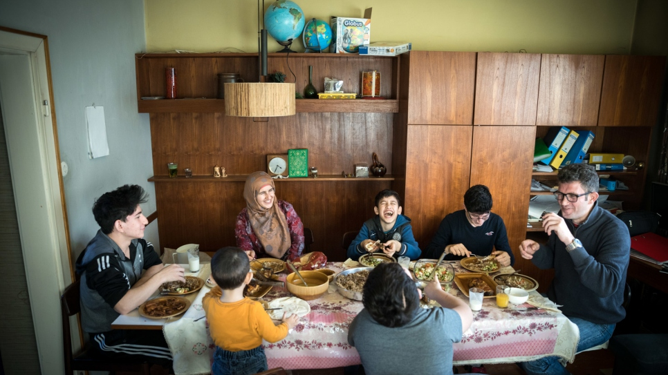 The reunited family, which has lived in Syria and Lebanon, enjoys lunch together in Austria.