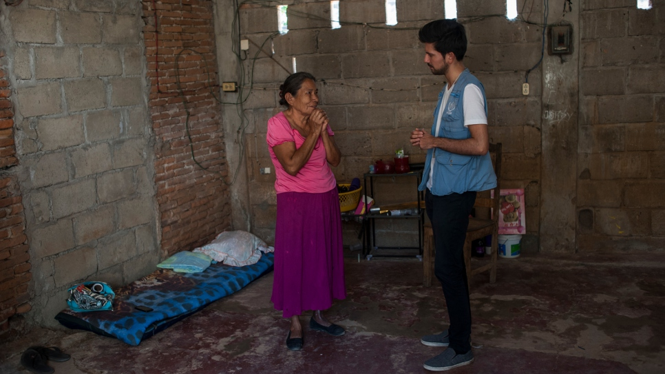 Margarita talks to a UNHCR protection officer in her modest home in southern Mexico.