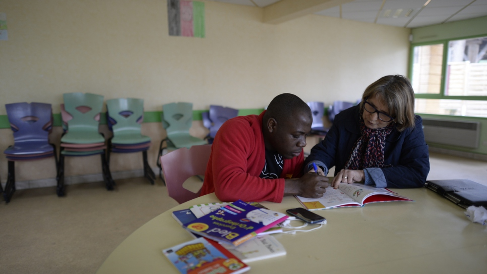 """When you see their desire to learn, it gives you a boost of energy,"" says Brigitte Dubosclard, a volunteer French teacher for refugees in Pessat-Villeneuve, France. The small town in central France converted its château into a reception centre that has welcomed 136 refugees."