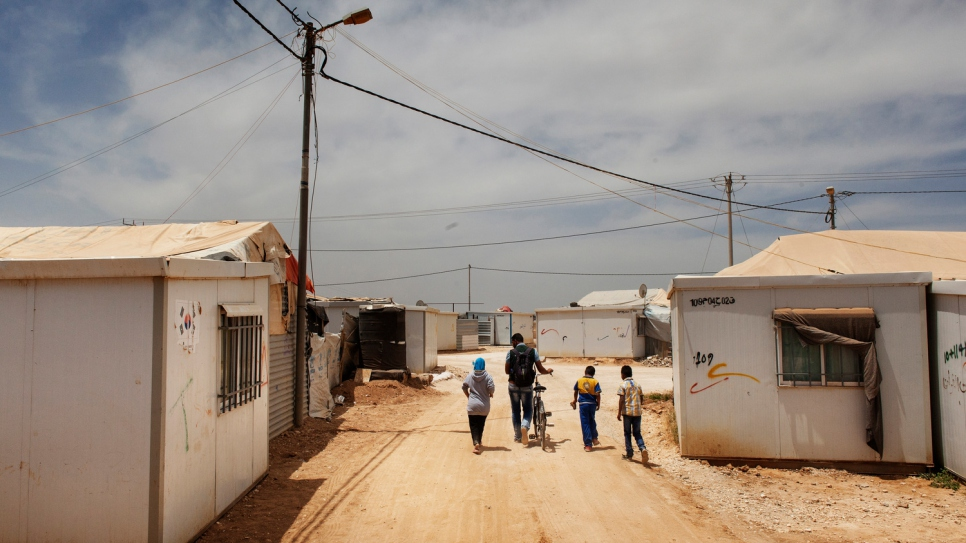 Fadi takes children to school at Za'atari refugee camp in Jordan.