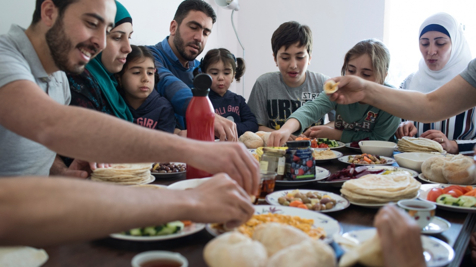 The Dabah family, who fled war in Syria in 2012, eat breakfast at their home in Lisbon, Portugal.