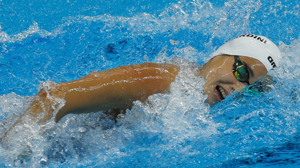 Yusra Mardini, an 18-year-old swimmer who fled the war in Syria, powers through the water in her last race of the 2016 Games.
