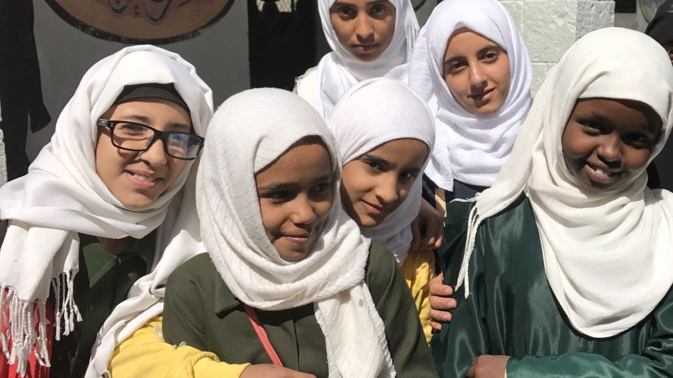 Despite conflict and adversity, Afrah, far right, is determined to stay in school in Yemen. Like millions of others caught up in Yemen's brutal conflict, 12-year-old Somali refugee Afrah's immediate concern is surviving the bombs, bullets and gnawing poverty it has created.