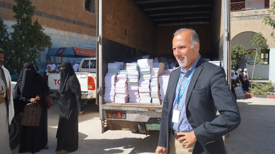 UNHCR's Country Representative in Yemen, Ayman Gharaibeh, during a handover of school books produced by UNHCR to the Asma School for Girls in Sana'a, to help support quality education for refugee and local children.