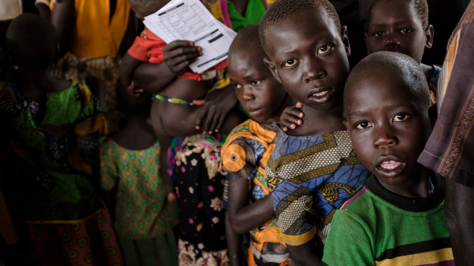 South Sudanese refugees queue to register at the Imvepi Reception Centre Arua District Northern Region Uganda