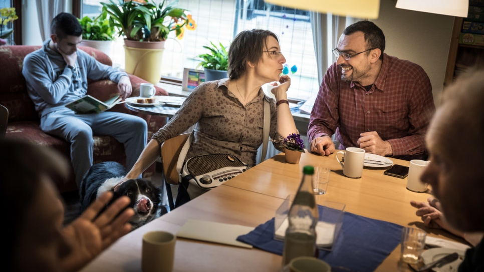 Cornelia, 44, who co-founded the refugee support network 'Welcome To Neu Wulmstorf', chats with Mustafa, 37, from Syria.