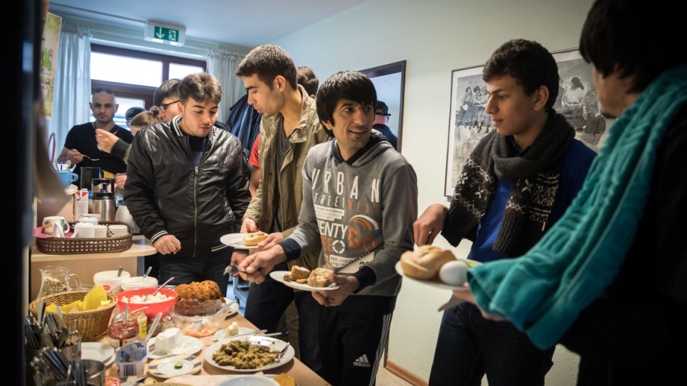 Afghan aslyum-seeker Salim Mohamadi, 22, (middle) chats with new friends at the local community centre.