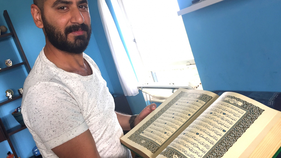 Wissam with his family Koran, one of the few things he brought from home.