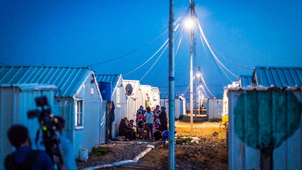 At last, Syrian refugees can enjoy the evening outside their shelters.