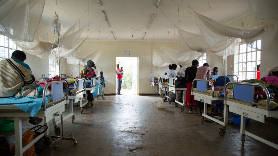 Parents visit their sick children at the health centre at Nakivale settlement.
