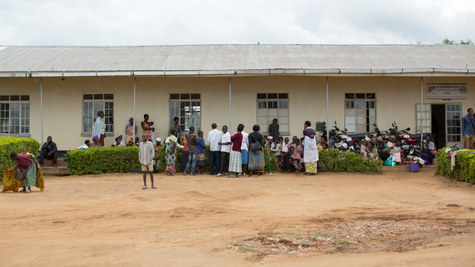Refugees and locals gather outside the health centre at Nakivale settlement.