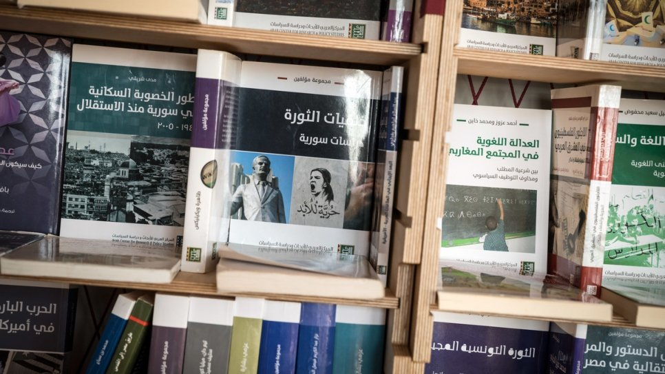 Books inside the library founded by Syrian literature student Muhannad.