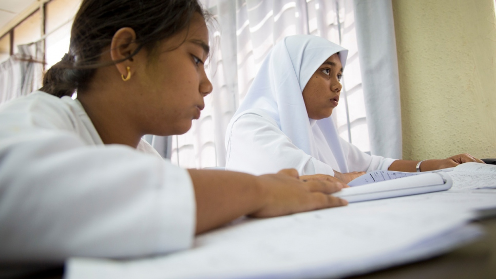 Shamshidah (right) and her 15-year-old sister Yasmin attend class at an informal school for refugees  in Kuala Lumpur, Malaysia.